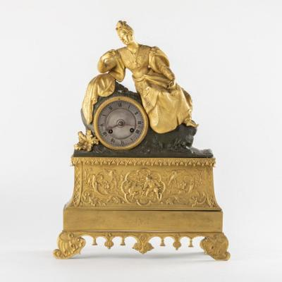 Pendule en bronze doré et à patine brune, XIXe