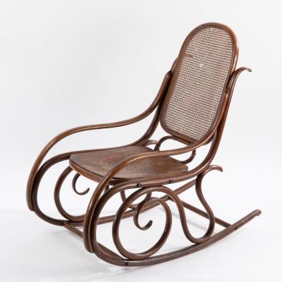Dans le goût de Thonet, Rocking-Chair en bois courbé teinté, XXe