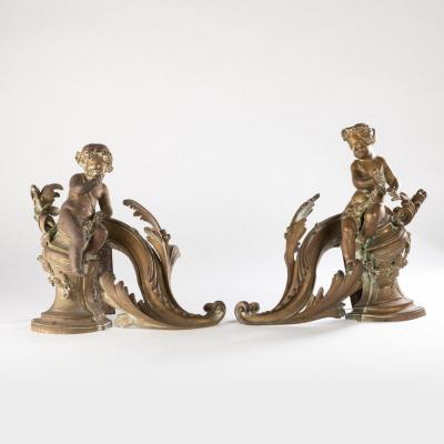 Paire de chenets aux petits Bacchus en bronze doré, XIXe