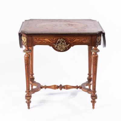 Table de salon à rabats à décor marqueté de trophées de musique et de rinceaux, XIXe
