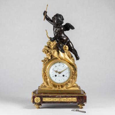 Guillaume Denière (1815-1901), pendule au Cupidon en bronze à patine brune et bronze doré, XIXe