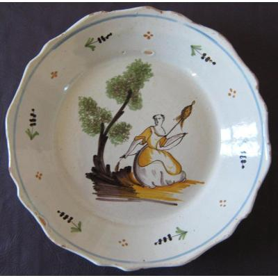 "De Nevers Faience Plate In Eighteenth Century In Decor A ""spinner""."