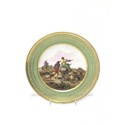 Assiette en Porcelaine de Paris attribué à Dagoty marli vert Empire et scène flamande peinte