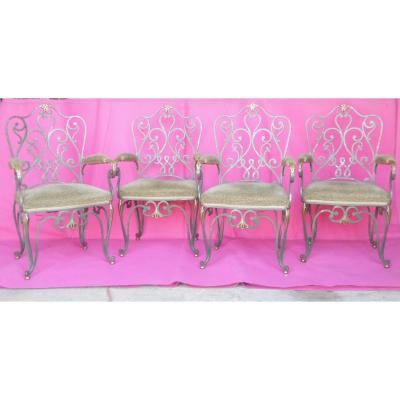 Four Wrought Iron Armchairs