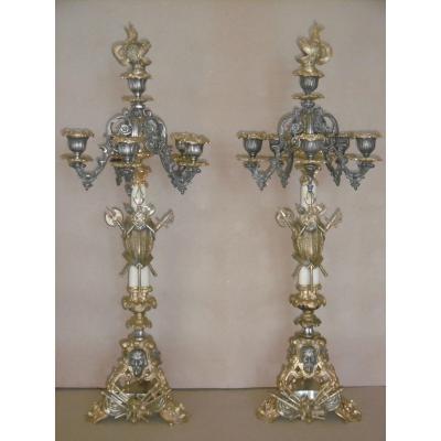 Paire de candélabres d'époque Restauration aux attributs