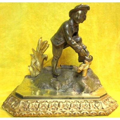 Sculpture Patineur chaussant patins bronze époque Restauration St 18éme