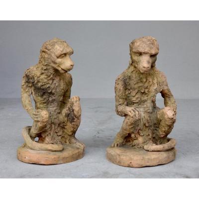 Paire de singes en terre cuite XIXe