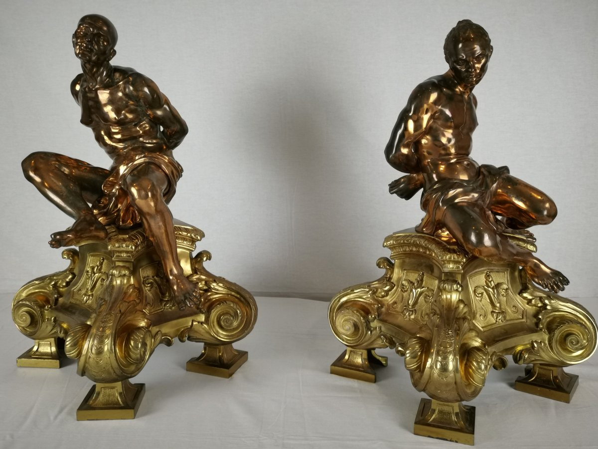 A Pair Of Gilt-bronze Slaves Fire Dogs, After A Model By Pietro Tacca, In 17th Century Taste.