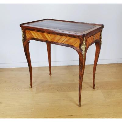 A Louis XV marquetry table, known as &quot;&agrave; billets doux&quot;.<br />