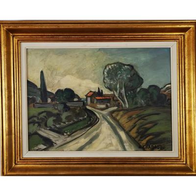 Auguste CHABAUD 1882 - 1955 - Le chemin du mas. Oil on cardboard signed lower right &quot;A. CHABAUD.&quot; On the back is a preparatory drawing in grease pencil of a similar subject. Dimensions: Box height: Height 38.5cm Width: 53cm - Frame height 55.5cm Width 70cm. French painter and sculptor Auguste Chabaud was born on October 3, 1882 in N&icirc;mes. He died on May 23, 1955 in Graveson. Pupil of Pierre Grivolas at the Ecole des Beaux Arts in Avignon, Auguste Chaubaud, following the advice of his teacher, went into exile in Paris in 1899. There, he enrolled in Fernand Cormon&#39;s studio and attended academies Jullian and Carri&egrave;re. In Paris, he also rubs shoulders with Matisse, Puy and Derain. In Paris, Chabaud exhibits at the Salon des Ind&eacute;pendants and the Salon d&#39;Automne, alongside the main protagonists of Fauvism. The vehemence of the brushstroke, a certain feeling of the unfinished (resulting in him by a great simplification of the drawing), the use of pure colors, are all characteristics that he shares with the Fauve artists. In Montmartre, where he has his studio, Chabaud paints busy streets and deserted squares, in a rapid, synthetic writing, sometimes close to caricature. His paintings from the Fauve period perfectly describe Parisian nightlife: cabarets, theater cafes, prostitutes, in bright colors (yellow, red) contrasting with the colors of the night (navy blue, black). Juxtaposing the raw colors, outlining the shapes with a thick black line, Auguste Chabaud captures the figures frontally or brutally cuts their profile, describes the loneliness of men in the modern world. In 1913, Chabaud exhibited in New York alongside Matisse, Derain, Vlaminck and Picasso. On his return from the war in 1919, Auguste Chabaud settled permanently in Graveson, in the middle of the Alpilles. He stayed there until the end of his life, secluded in his house with his wife and seven children. As C&eacute;zanne had done with the Sainte Victoire, Chabaud immortalized &quot;the mountain&quot;, painting countryside scenes, peasants walking the hills and paths of the Alpilles. Devoid of any folklore, the Provence of Chabaud is monumental, burnt under the relentless light of the sun. The landscape, resolved into simple shapes, is built from a few emblematic elements, in a reduced chromaticism, gradually dominated by a dazzling Prussian blue. Proud of his roots, Chabaud will always claim an instinctive art and a marginal position in the artistic field. We can see some of his works at the Cantini museum in Marseille, at the Modern Art museum in Paris, at the Petit Palais museum in Geneva.<br />