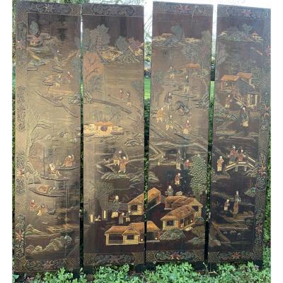 Paravant en laque de  4 gds panneaux double face décor peint et reliefs, têtes raportées