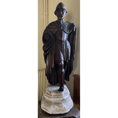 Large XVIth Cty Wooden Carved Statue, Soldier Wearing Cabasset And Coat+ XVth Cty Octogonal Stone Carved Stand