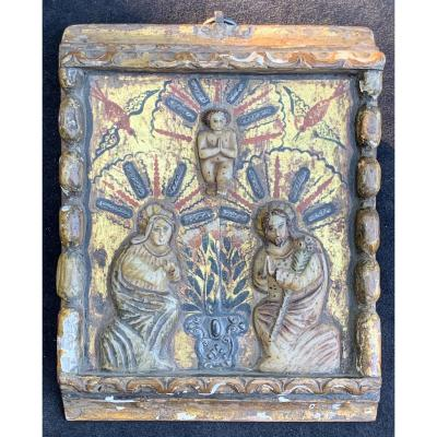 Wooden carved painted and gild panel with gilt albaster relief sculpture, and silver relief design. Religious thema with Holy Mother Marie, Joseph and Jesus between us,<br />
