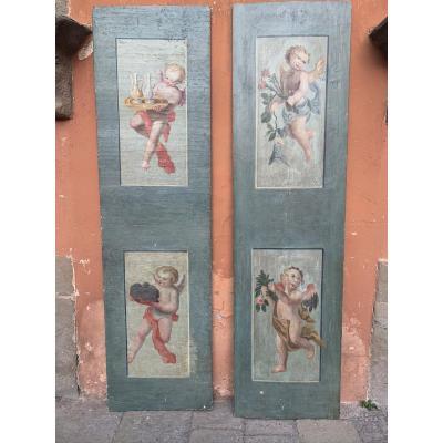 Deux Panneaux Peints Avec Quatre Putti.