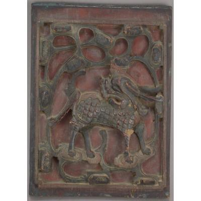 Chinese Polychrome Carved Wood Plaquette Representing A Qilin 19th Century