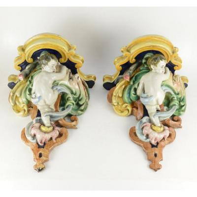 Pair Of Italian Polychrome Earthenware Consoles Stannifère Representing Cherubs 19th Century