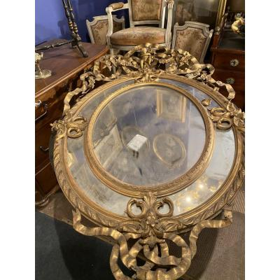 Large Oval-shaped Mirror, Frame In Wood And Golden Stucco With Putti Decor 19th