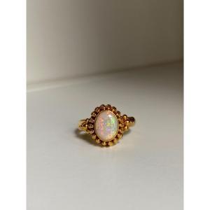 Belle bague en or 18k avec opale