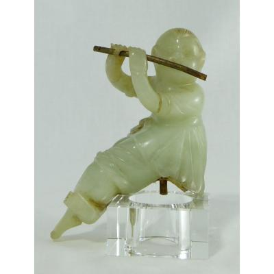 China Around 1900, Jade Sculpture Containing A Child Playing The Flute.