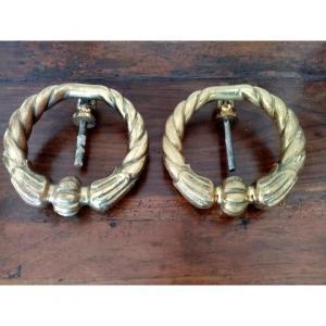 Paire de heurtoirs en bronze doré