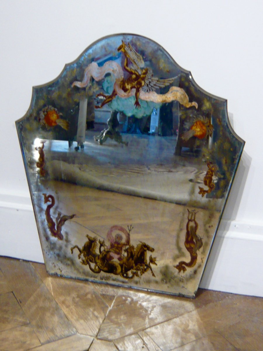 Decorative mirror painted on glass with motifs of newts, mermaids, angel heads, around the perimeter.<br /> Decorations inspired by Italy and its scenography. Signed lower left. Ir&egrave;ne F&eacute;licienne Marie born in 1889 in Paris,<br /> died near Paris in 1976. All her existence was devoted to art, and her talent, with its multiple manifestations, was<br /> enthusiasm by critics and the most enlightened amateurs.&nbsp;