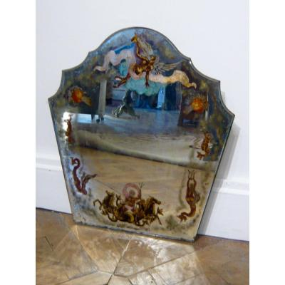 Decorative mirror painted on glass with motifs of newts, mermaids, angel heads, around the perimeter.<br />