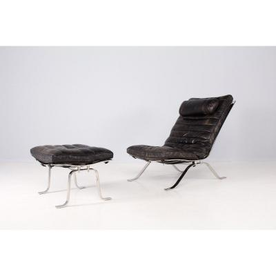 Lounge Chair In Leather And Its Ottoman.