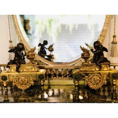 Pair Of Andirons In Gilt Bronze And Patina With Fire Pots And Cupids. Louis XVI Style