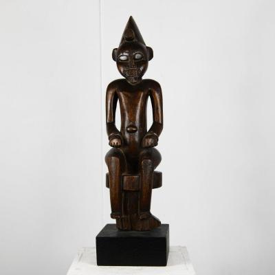 Statue Assie Du Poro